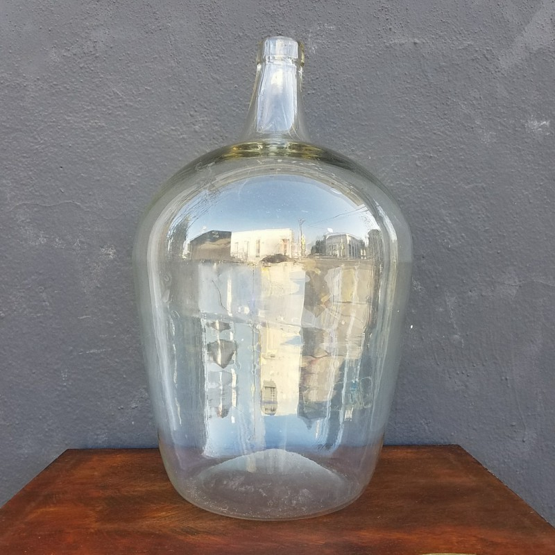 Large Clear Glass Bottle and Large Green Planter